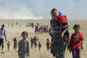 Famiglie Yezide in fuga - Genocidio Yezidi 2014